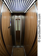 Claustrophobic elevator - Narrow, claustrophobic elevator...