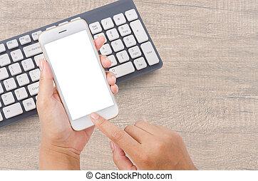clavier, smartphone, computer., tenant main