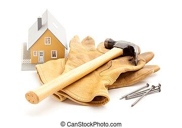clavos, guantes, martillo, hogar, y