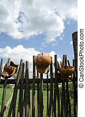 clay broken pitchers hang wooden rural woven fence