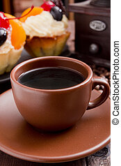 Clay coffee cup with cakes
