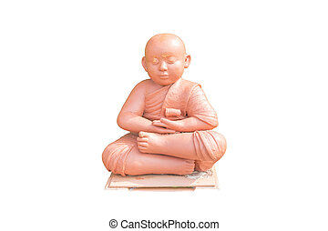 Clay doll of Buddhist novice holding sitting for meditation