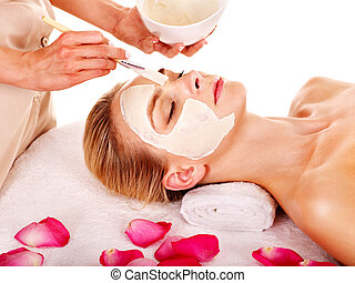 Clay facial mask in beauty spa. - Woman with clay facial ...