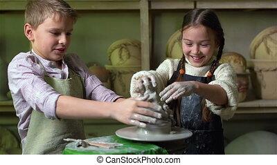 Clay Fun - Siblings having fun playing with clay on a...