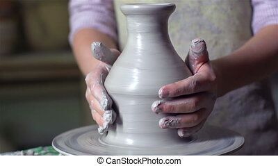 Clay Handicraft - Tilt up of a schoolboy being concentrated ...