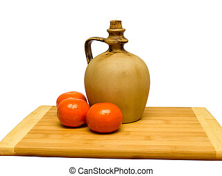 Clay jug on a wooden board
