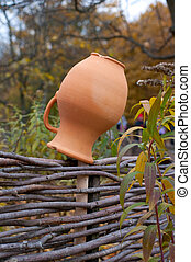 Clay jug on fence, a village tradition in Ukraine.