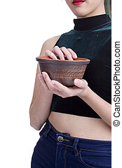 Clay plate in the hands of