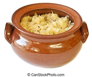 Clay pot filled with traditional homemade sauerkraut