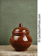clay pot on an old wooden table