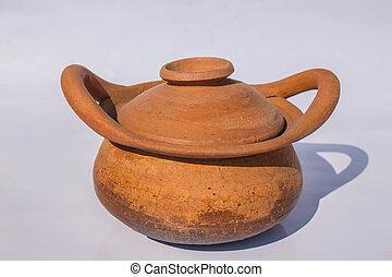 Clay pot on background.