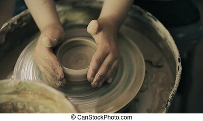 clay potter hands wheel pottery work workshop teacher and girl pupil 4k