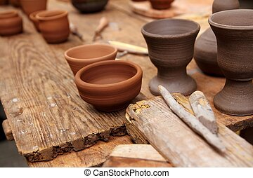 clay pottery potter handcrafts on vintage table