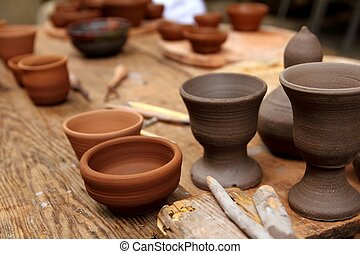 clay pottery potter handcrafts on vintage table - clay...