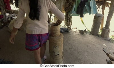 Clay processing - Young woman uses an ancient and ...