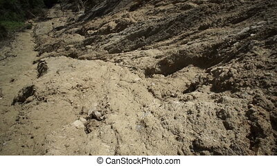 Clay Soil Landslide Tilt Up - Tilt up shot of a large clay...