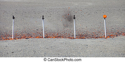 Clay targets being dusted by shotgun