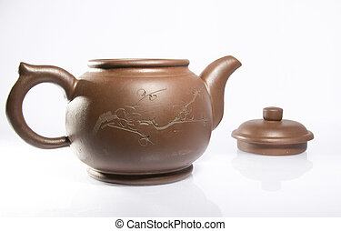 Clay teapot isolated on a white background
