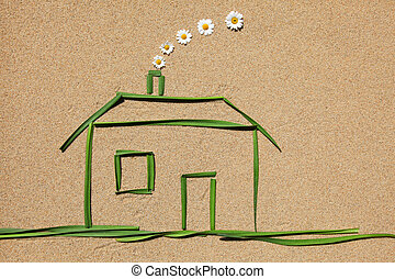 Clean air concept: house - A house made of grass on a sandy ...