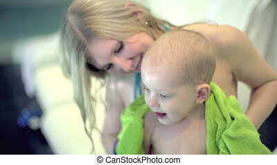 Clean and Dry - High angle of young mother wiping her child...