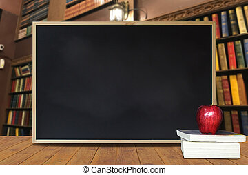 Clean black chalkboard texture with red apple on stacked book on wood table with library as background. Black to school concept. advertising, sale. education concept.