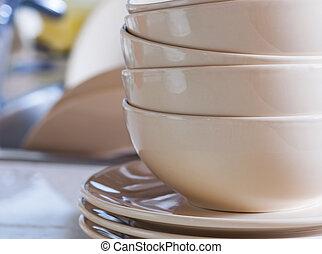 Clean dishes in kitchen sink.