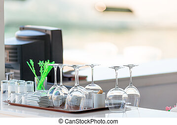 clean dishes on the bar in a summer cafe