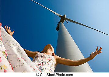 clean energy for the children's future - girl playing in the...