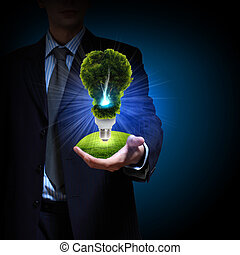 clean energy. green light bulb