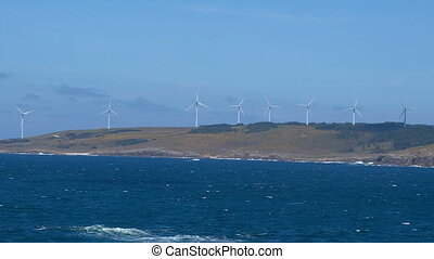Clean energy production with ocean wind turbines farm, green...