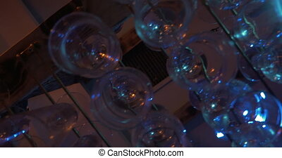 Clean glassware hanging in the bar - Steadicam bottom shot...