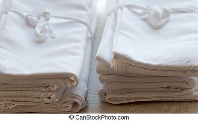 Clean Linen - a pile of clean linen towels