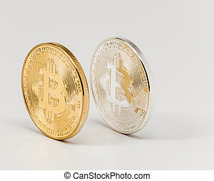 Clean looking replica bit coins one is gold and the other silver