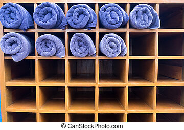 Clean nice shape of blue rolled towel in wooden box