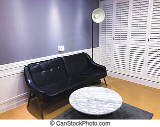 Clean room with sofa, coffee table and lamp
