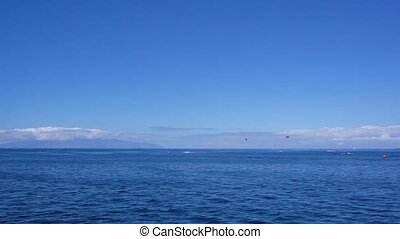Clean sea water and clear blue sky with horizont