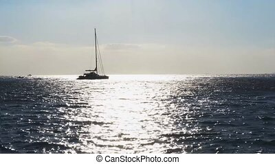 Clean sea water - sea water, yacht boat and sunshine in back...