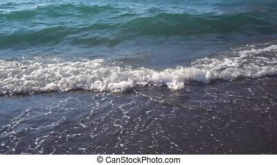Clean sea water waves at amalfitana coast, Italy