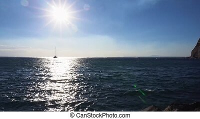 Clean sea water with sun path and ship