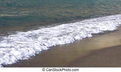 Clean sea water with waves at amalfitana beach, Italy