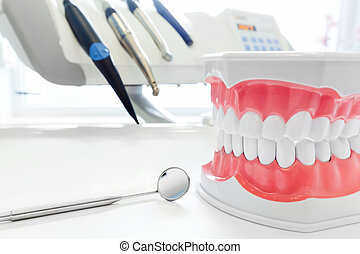 Clean teeth dental jaw model, mirror and dentistry...