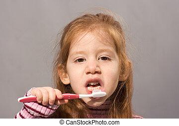 Clean teeth - Girl brushing her teeth with toothbrush