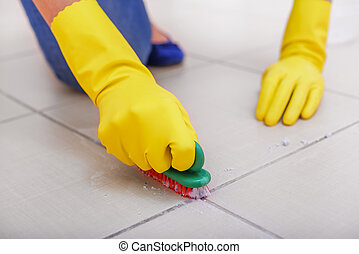 Clean the tiles on the floor.