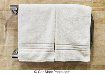 clean towels drying on the heated
