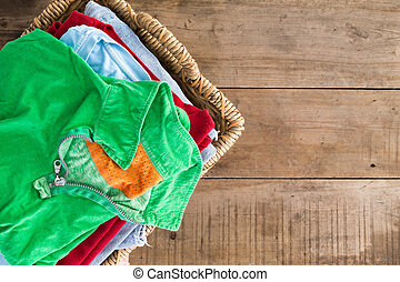 Clean unironed summer clothes in a laundry basket - Clean ...