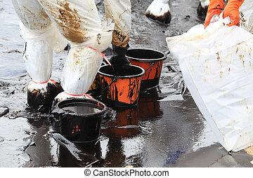 clean up Crude oil stain at Ao Prao Beach in , Rayong, Thailand