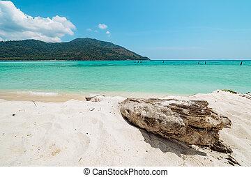 Clean white sand and pristine blue ocean