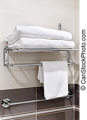 Clean white towel on a hanger