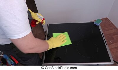 Cleaner cleaning surface of electric cooker
