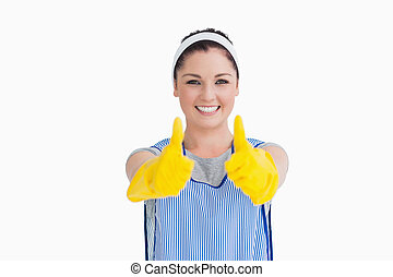 Cleaner giving thumbs up with yellow gloves